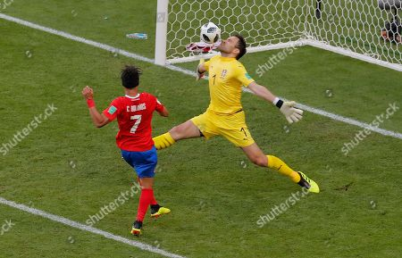 Costa Rica's Christian Bolanos, left, tries to score as Serbia goalkeeper Vladimir Stojkovic makes a save during the group E match between Costa Rica and Serbia at the 2018 soccer World Cup in the Samara Arena in Samara, Russia