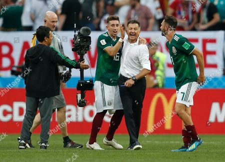 Mexico head coach Juan Carlos Osorio, center right, celebrates with players Hector Herrera, center left, and Miguel Layun during the group F match between Germany and Mexico at the 2018 soccer World Cup in the Luzhniki Stadium in Moscow, Russia