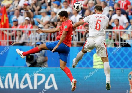 Daniel Colindres, Branislav Ivanovic. Costa Rica's Daniel Colindres fights for the ball against Serbia's Branislav Ivanovic during the group E match between Costa Rica and Serbia at the 2018 soccer World Cup in the Samara Arena in Samara, Russia