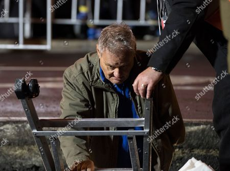 Artist Mike Parr emerges after 72 hours underneath Hobart's Macquarie St during Tasmania's Dark Mofo festival in Hobart, Australia, 17 June 2018. The performance is called 'Underneath The Bitumen The Artist'.