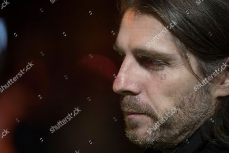 Stock Image of Dark Mofo creative director Leigh Carmichael is seen as Hobart's Macquarie St is excavated to release artist Mike Parr during Tasmania's Dark Mofo festival in Hobart, Australia, 17 June 2018.The performance is called 'Underneath The Bitumen The Artist'.