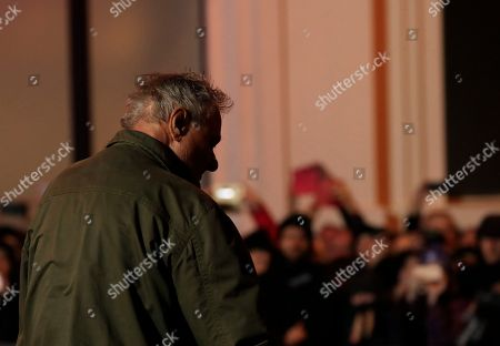 Stock Picture of Artist Mike Parr emerges after 72 hours underneath Hobart's Macquarie St during Tasmania's Dark Mofo festival in Hobart, Australia, 17 June 2018. The performance is called 'Underneath The Bitumen The Artist'.