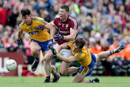 Roscommon vs Galway. Galway?s Gareth Bradshaw tackled by Tadgh O'Rourke and David Murray of Roscommon