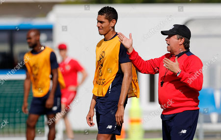 Panama head coach Hernan Gomez (R) and player Valentin Pimentel during a training session of team Panama at the Olympic Park Arena in Sochi, Russia, 17 June 2018.