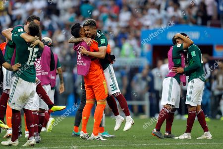 Mexico's Carlos Salcedo, center right, and goalkeeper Alfredo Talavera celebrate at the end of the group F match between Germany and Mexico at the 2018 soccer World Cup in the Luzhniki Stadium in Moscow, Russia