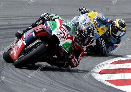 British MotoGP rider Scott Redding (L), Ducati Pramac, and Swiss Thomas Luthi (R), Marc VDS, compete during the race in the Catalan Motorcycle Grand Prix held at Montmelo circuit in Barcelona, Spain, 17 June 2018.