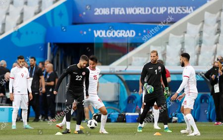 Tunisia goalkeeper Mouez Hassen, (22) and Tunisia's Ahmed Khalil vie for the ball on the pitch of the Volgograd Arena during a training session for the 2018 soccer World Cup, in Volgograd, Russia, . Tunisia play England in a group G match in Volgograd, Monday June 18
