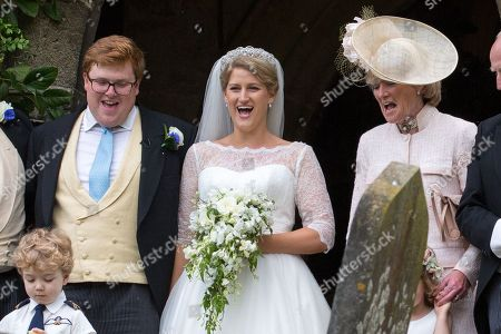 Stock Image of Celia McCorquodale and George Woodhouse and Lady Sarah McCorquodale (right) in Stoke Rochford, Lincolnshire on June 16th after their wedding.The bride wore Princess Diana's tiara