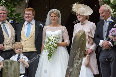 Stock Photo of Celia McCorquodale and George Woodhouse and Lady Sarah McCorquodale (right) in Stoke Rochford, Lincolnshire on June 16th after their wedding.The bride wore Princess Diana's tiara.