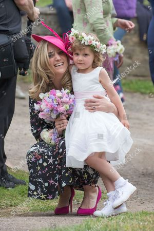 A flower girl attending the wedding of Celia McCorquodale
