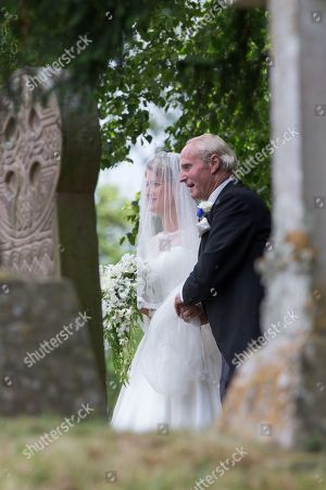 Mr Neil McCorquodale and his daughter Celia McCorquodale arriving for the wedding in Stoke Rochford, Lincolnshire on June 16th.The bride wore Princess Diana's tiara