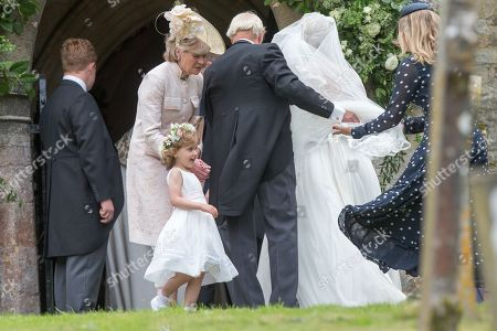 Celia McCorquodale about to enter the church in Stoke Rochford, Lincolnshire on June 16th for her wedding