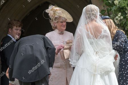 Celia McCorquodale about to enter the church in Stoke Rochford, Lincolnshire on June 16th for her wedding. Also pictured is her mother Lady Sarah McCorquodale