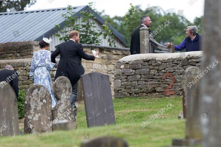 Meghan Duchess of Sussex and Prince Harry leaving the wedding of Celia McCorquodale