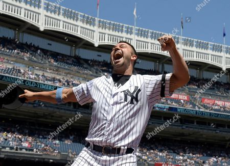 New York Yankees' Nick Swisher reacts when he is introduced at the Yankees Old Timer's Day baseball game, at Yankee Stadium in New York
