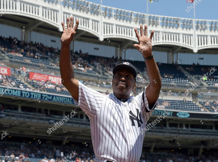 Stock Image of New York Yankees' Willie Randolph reacts when he is introduced at the Yankees Old Timers' Day baseball game, at Yankee Stadium in New York