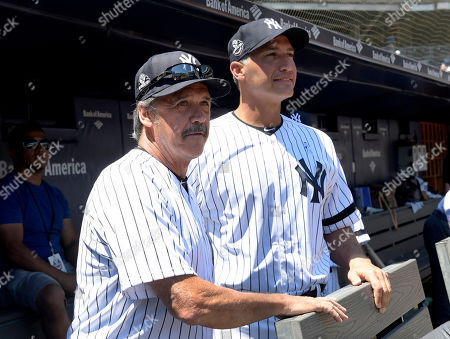 Stock Picture of New York Yankees' Ron Guidry, left. and Andy Pettitte look on from the dugout before the Yankees Old Timers' Day baseball game, at Yankee Stadium in New York