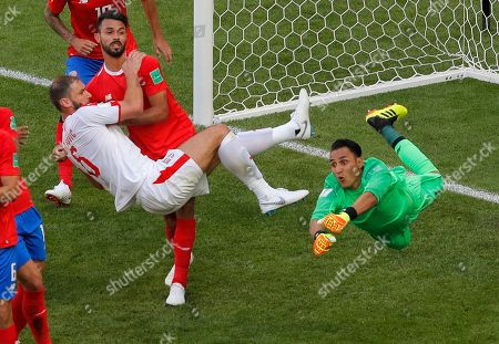Serbia's Branislav Ivanovic, left, tries to score past Costa Rica goalkeeper Keylor Navas during the group E match between Costa Rica and Serbia at the 2018 soccer World Cup in the Samara Arena in Samara, Russia