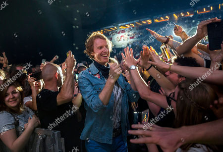 Richard Reed Parry of the Canadian indie rock band Arcade Fire (C) greets members of the audience prior to their concert in Papp Laszlo Sports Arena in Budapest, Hungary, 17 June 2018.