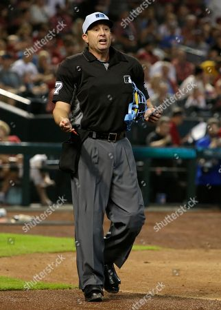 MLB umpire Jim Reynolds (77) ejects New York Mets relief pitcher Jason Vargas in the fourth inning during a baseball game against the Arizona Diamondbacks, in Phoenix. Vargas was on the bench and not in the game