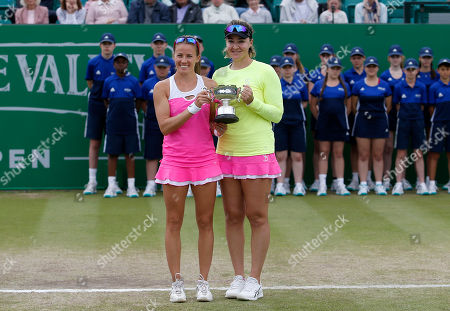 Poland's Alicja Rosolska and Abigail Spears of USA receive the trophy