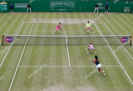 Abigail Spears of USA plays a winning shot in the ladies doubles final