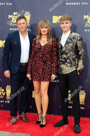 Canadian actor Lochlyn Munro (L), US actress Madchen Amick (C) and US actor Hart Denton (R) arrive for the 2018 MTV Movie and TV Awards at the Barker Hanger in Santa Monica, California, USA, 16 June 2018 (issued 18 June 2018). The movies are nominated by producers and executives from MTV and the winners are chosen online by the general public.