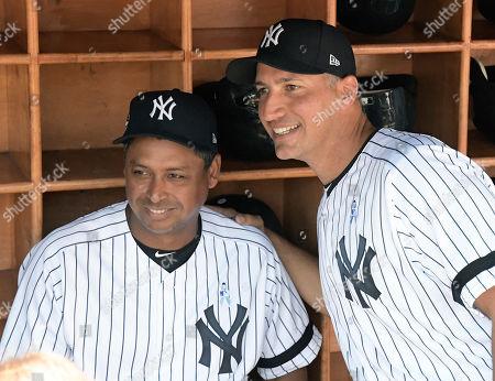 Andy Pettitte, Ramiro Mendoza. New York Yankees' Ramiro Mendoza, left, and Andy Pettitte in the dugout before the Yankees Old Timers' Day baseball game, at Yankee Stadium in New York