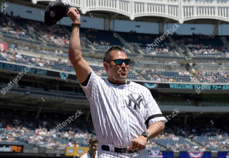 New York Yankees' Johnny Damon waves to the crowd as he is introduced at the Yankees Old Timers' Day baseball game, at Yankee Stadium in New York