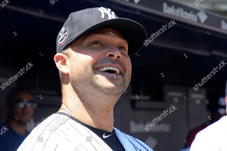New York Yankees' Nick Swisher waits to be introduced at the Yankees Old Timers' Day baseball game, at Yankee Stadium in New York