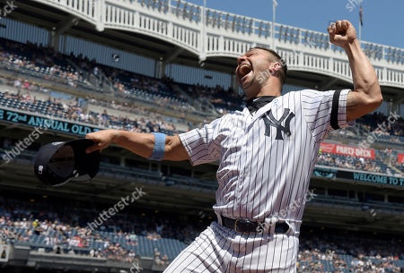 Stock Image of New York Yankees' Nick Swisher reacts when he is introduced at the Yankees Old Timer's Day baseball game, at Yankee Stadium in New York