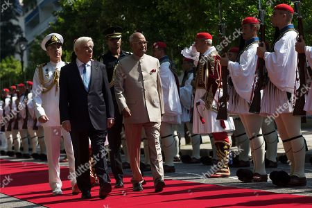 Ram Nath Kovind, Karolos Papoulias. Indian President Ram Nath Kovind, right, escorted by Greek President Karolos Papoulias, inspect a guard of honor outside the Presidential palace in Athens, on . The Indian President is in Athens on a two-day official visit