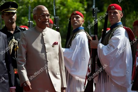 Indian President Ram Nath Kovind, center, is escorted by Greek President Karolos Papoulias, as they inspect a guard of honor outside the Presidential palace in Athens, on . The Indian President is in Athens on a two-day official visit