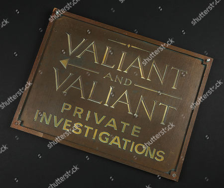 A 'Valiant and Valiant Private Investigations' office sign from Robert Zemeckis' Oscar winning detective comedy Who Framed Roger Rabbit. Signs were used on the outside of Eddie Valiant's (Bob Hoskins) office building, most notably in the sequence when Valiant fixes the sign so it hangs straight