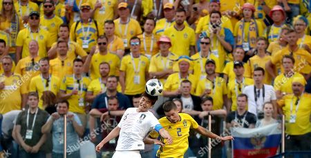 Mikael Lustig of Sweden and Park Joo-ho of South Korea