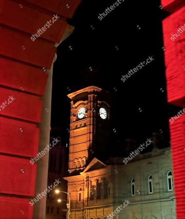The Hobart Town Hall and the GPO are colored red as Hobart's Macquarie St is excavated to release artist Mike Parr during the Dark Mofo festival in Hobart, Tasmania, Australia, 17 June 2018.
