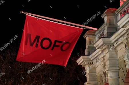 Dark Mofo flags adorn the Hobart Town Hall as Hobart's Macquarie St is excavated to release artist Mike Parr during the Dark Mofo festival in Hobart, Tasmania, Australia, 17 June 2018.