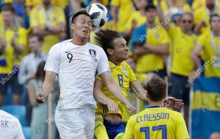 Kim Shin-wook, Albin Ekdal. South Korea's Kim Shin-wook, left, vies for the ball with Sweden's Albin Ekdal during the group F match between Sweden and South Korea at the 2018 soccer World Cup in the Nizhny Novgorod stadium in Nizhny Novgorod, Russia
