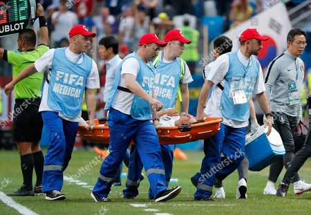 South Korea's Park Joo-ho is carried from the pitch after getting injured during the group F match between Sweden and South Korea at the 2018 soccer World Cup in the Nizhny Novgorod stadium in Nizhny Novgorod, Russia