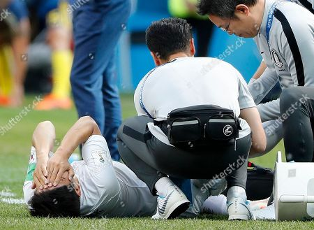 South Korea's Park Joo-ho reacts after getting injured during the group F match between Sweden and South Korea at the 2018 soccer World Cup in the Nizhny Novgorod stadium in Nizhny Novgorod, Russia
