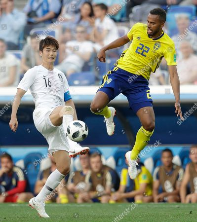 South Korea's Park Joo-ho, left, and Sweden's Isaac Kiese Thelin compete for the ball during the group F match between Sweden and South Korea at the 2018 soccer World Cup in the Nizhny Novgorod stadium in Nizhny Novgorod, Russia