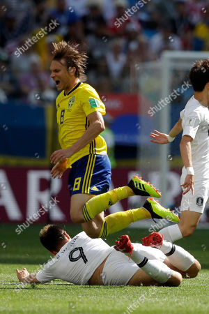 Sweden's Albin Ekdal is tackled by South Korea's Kim Shin-wook during the group F match between Sweden and South Korea at the 2018 soccer World Cup in the Nizhny Novgorod stadium in Nizhny Novgorod, Russia