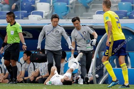 South Korea's Park Joo-ho grimaces in pain after a tackle during the group F match between Sweden and South Korea at the 2018 soccer World Cup in the Nizhny Novgorod stadium in Nizhny Novgorod, Russia