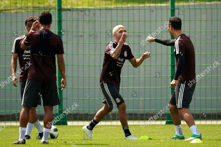 Mexico's players Jesus Corona (C), Giovani dos Santos (L) and Rafael Marquez share a light moment during a regenerative training session in Moscow, Russia, 18 June 2018. Mexico will face South Korea in the FIFA 2018 World Cup Group F soccer match at Rostov Arena on 23 June.