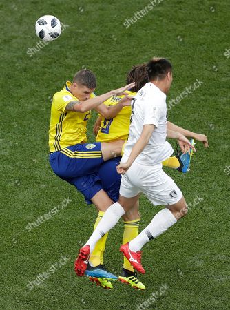 South Korea's Kim Shin-wook, right, vies for the ball with Sweden's Mikael Lustig, left, and Marcus Berg during the group F match between Sweden and South Korea at the 2018 soccer World Cup in the Nizhny Novgorod stadium in Nizhny Novgorod, Russia