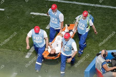 South Korea's Park Joo-ho is carried on stretchers from the pitch during the group F match between Sweden and South Korea at the 2018 soccer World Cup in the Nizhny Novgorod stadium in Nizhny Novgorod, Russia