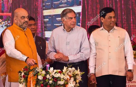 Stock Photo of Tata Trusts Chairman Ratan Tata, center, Bharatiya Janata Party President Amit Shah, left, and Indian northeastern state of Assam Chief Minister Sarbananda Sonowal, right, lay the foundation stone of a cancer care hospital in Gauhati, India, . Assam government and Tata Trusts have joined hands to set up the cancer care grid comprising 18 hospitals and an apex research and development multi-specialty unit in the state
