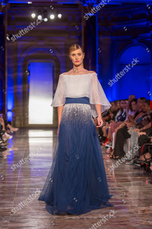 Model on the catwalk showing creations by the fashion designers Carlo Pignatelli and Renato Balestra at the Rome Inclusive Fashion Night.