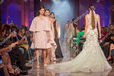 Models on the catwalk showing creations by the fashion designers Carlo Pignatelli and Renato Balestra at the Rome Inclusive Fashion Night.