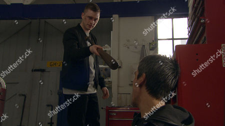 Stock Image of Ep 8190 Friday 29th June 2018 Cain Dingle, as played by Jeff Hordley, is busy working on a car when out of the blue is hit to the floor. We then see a bloodied and bruised Simon, as played by Liam Ainsworth, menacing as he raises a spanner to hit Cain once again.